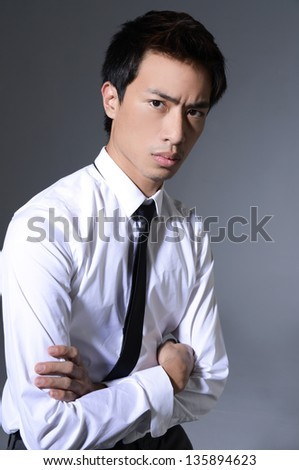 Friendly and smiling businessman looking at camera with reliability - stock photo