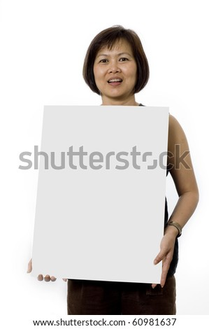 Friendly Asian woman holding white board ready for text - stock photo