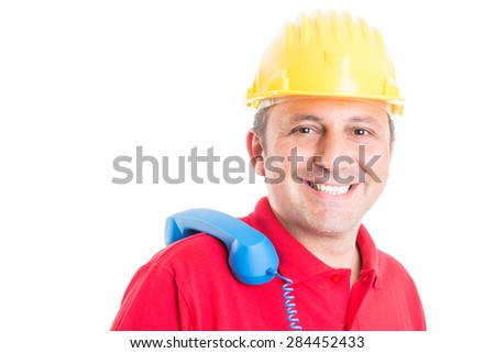 Friendly builder waiting for call concept with male worker holding phone on the shoulder - stock photo