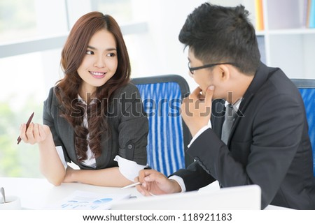 Friendly business people discussing the latest financial results - stock photo