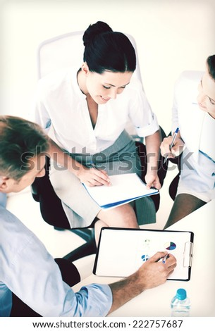 friendly business team having discussion in office - stock photo