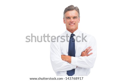 Friendly businessman with crossed arms looking to the camera - stock photo