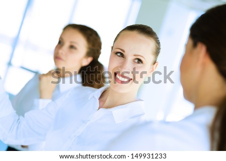 friendly businessmen discussing a joint task, team work - stock photo