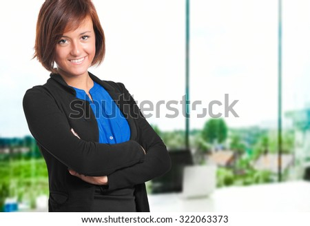 Friendly businesswoman in her office - stock photo