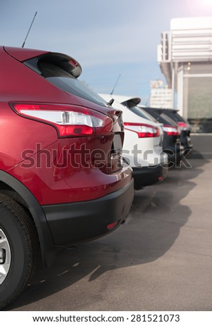 friendly cars are parked in a row - stock photo