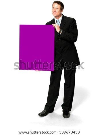Friendly Caucasian man with short black hair in business formal outfit holding large sign - Isolated - stock photo