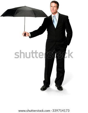 Friendly Caucasian man with short black hair in business formal outfit holding umbrella - Isolated - stock photo