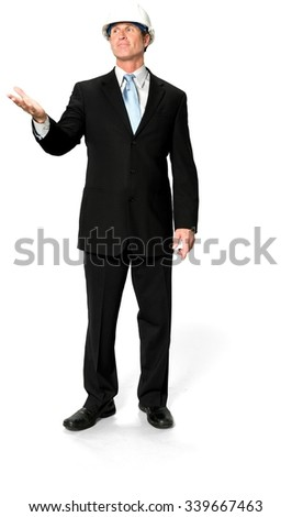 Friendly Caucasian man with short black hair in business formal outfit pointing using palm - Isolated - stock photo