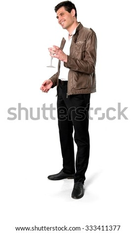 Friendly Caucasian man with short dark brown hair in casual outfit holding martini glass - Isolated - stock photo