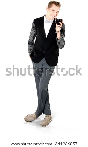 Friendly Caucasian young man with short light blond hair in evening outfit holding wine glass - Isolated - stock photo