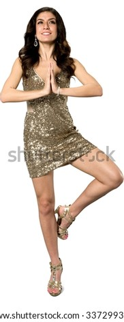 Friendly Caucasian young woman with long dark brown hair in evening outfit with meditation hands - Isolated - stock photo