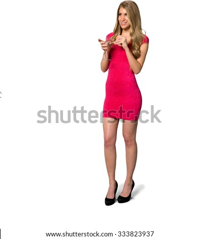 Friendly Caucasian young woman with long light blond hair in evening outfit holding martini glass - Isolated - stock photo