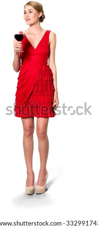 Friendly Caucasian young woman with medium blond hair in evening outfit holding wine glass - Isolated - stock photo