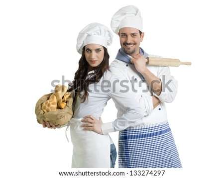 friendly chefs with bread and rolling pin - stock photo