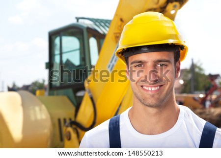 Friendly construction worker with his excavator - stock photo