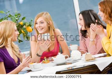 Friendly conversation of four pretty girls during lunch - stock photo