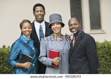 Friendly Couples Going to Church on Sunday - stock photo