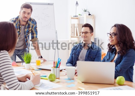 Friendly creative team is working in office - stock photo