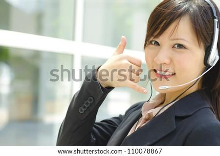 Friendly Customer Representative with headset. - stock photo