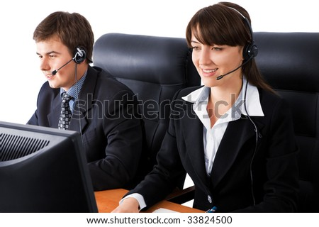 Friendly customer support team working at the office over a white background - stock photo