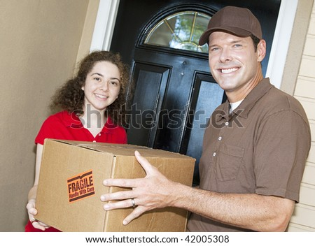 Friendly delivery man handing a package to a customer.  Focus on the man. - stock photo