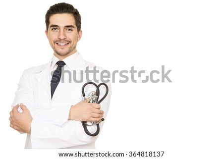 Friendly doctor. Portrait of a handsome happy doctor holding stethoscope smiling to the camera against white background - stock photo