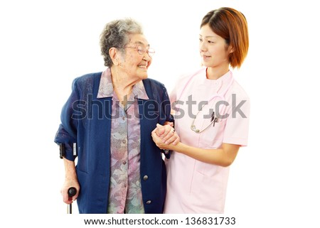 Friendly doctor with elderly woman - stock photo