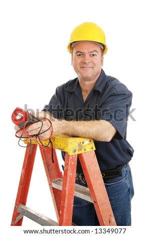 Friendly electrician holding a voltage meter and standing on a non-conductive fiberglass ladder.  Isolated on white. - stock photo