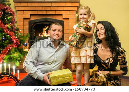 Friendly Family with new year's gifts - stock photo
