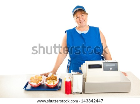 Friendly fast food worker serves food and runs the cash register.  White background. - stock photo
