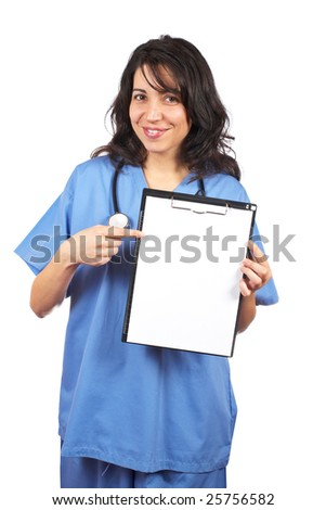Friendly female doctor in blue scrubs, showing a blank clipboard, over a white background. - stock photo