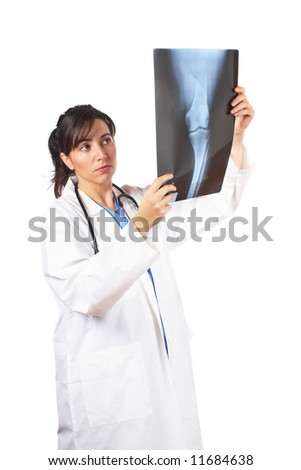 Friendly female doctor in lab coat , examining x-ray against white background - stock photo
