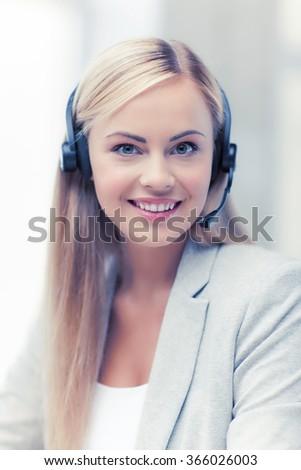 friendly female helpline operator - stock photo