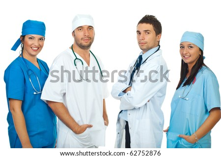 Friendly four different doctors standing in a row isolated on white background - stock photo