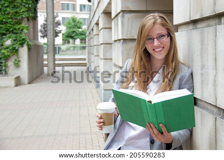 Friendly girl outside on campus - stock photo
