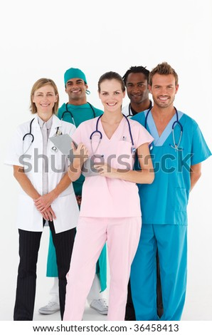 Friendly group of multi-ethnic doctors smiling at the camera - stock photo