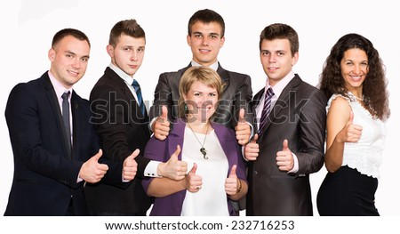 """Friendly harmonious business team makes """"good"""" gesture. Six people dressed in line with business dress code enjoy working together - stock photo"""
