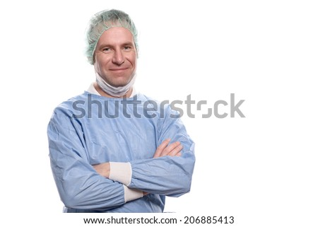 Friendly male nurse or doctor in surgical scrubs wearing a theatre gown, mask, goggles and a cap looking directly at the camera, head and shoulders isolated on white - stock photo