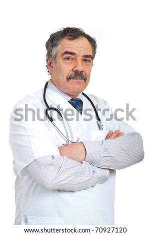 Friendly mature doctor man standing with arms folded isolated on white background - stock photo