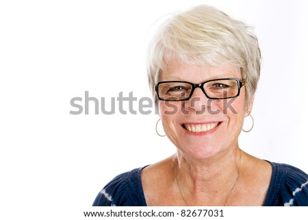 Friendly, mature white haired woman wearing glasses with a smile. - stock photo