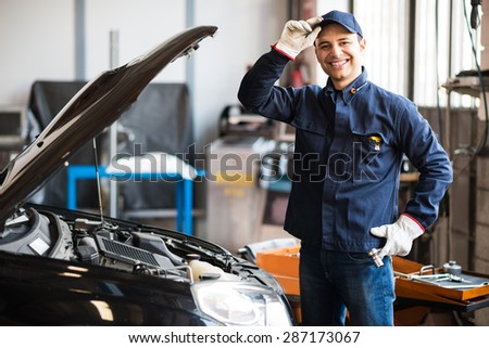Friendly mechanic portrait - stock photo
