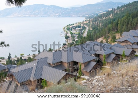 Friendly neighborhood of houses at the mountain. - stock photo