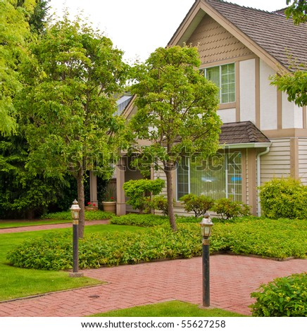 Friendly neighborhood of townhouses in North Vancouver, Canada. - stock photo