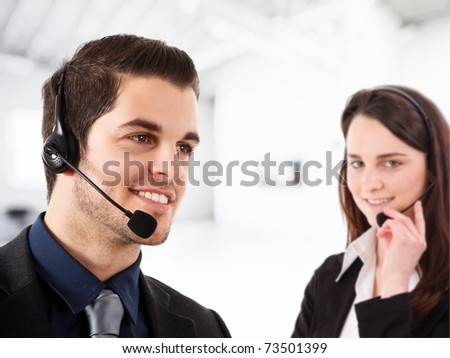 Friendly phone operator at work in an office environment. - stock photo