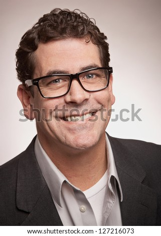 Friendly professional man with glasses closeup portrait - stock photo