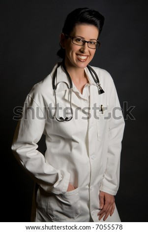 Friendly retro styled female health care professional - stock photo