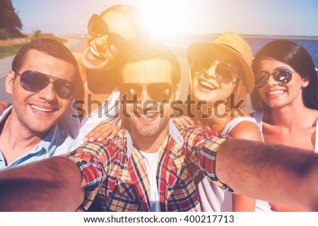 Friendly selfie. Five young happy people making selfie and smiling - stock photo
