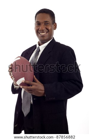 Friendly smiling black businessman holding a football isolated over white background - stock photo