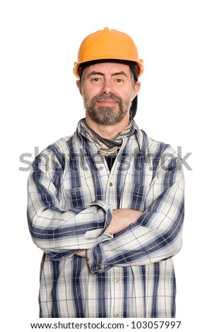 Friendly smiling construction worker in a protective helmet. - stock photo