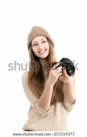 Friendly smiling female photographer holding slr camera, traveling photography, hobby, teenagers activity - stock photo